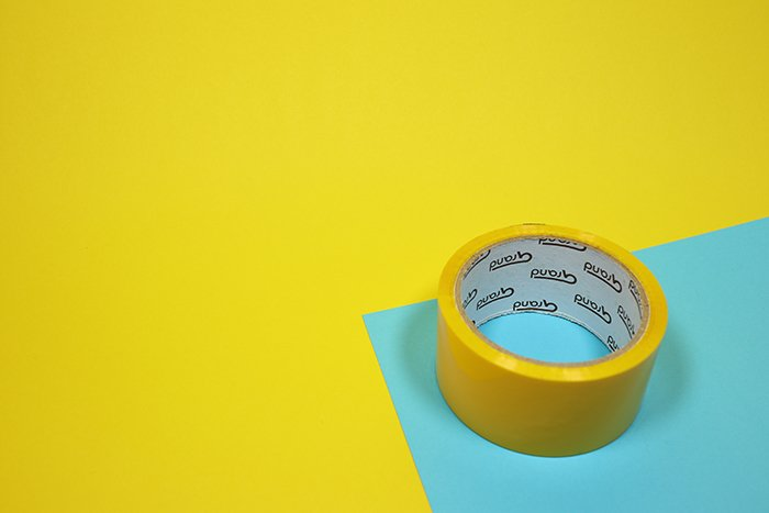 A roll of tape on blue and yellow background for making heart shaped bokeh photography