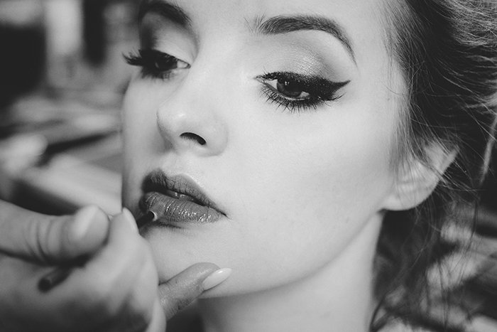 A female model having her make up done for a Hollywood glamour portrait shoot