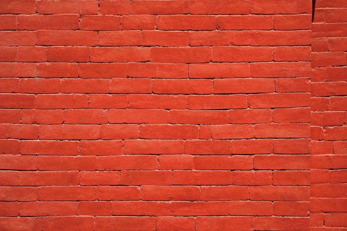 A minimalist photo of a brick wall using monotone color scheme