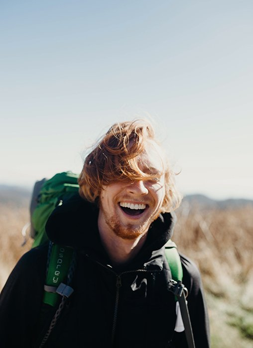 A smiling male hiker - how to smile for pictures