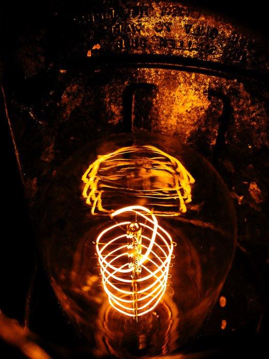 smartphone product shot of a lightbulb on dark background