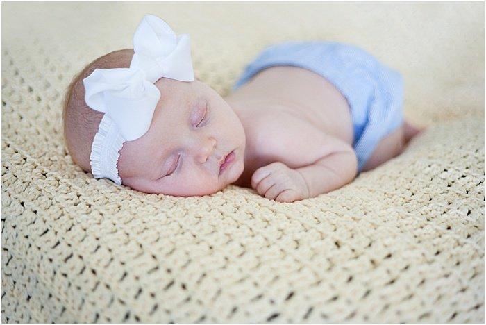 A sweet portrait of a newborn baby taken in a portable photo studio