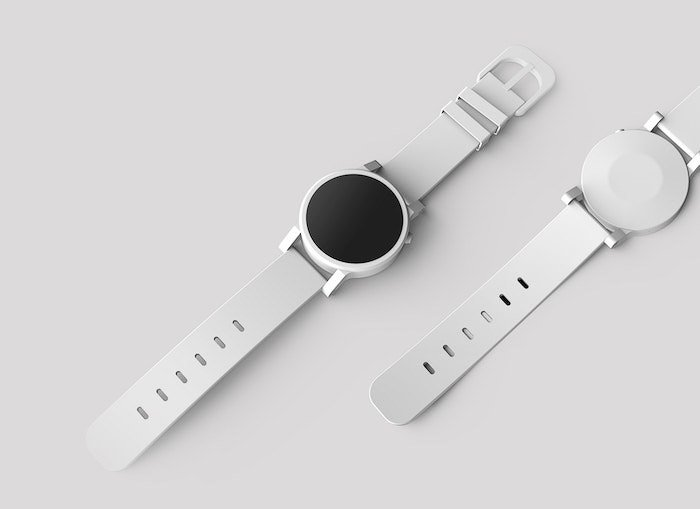 Flatlay product shot of a white watch on a white table