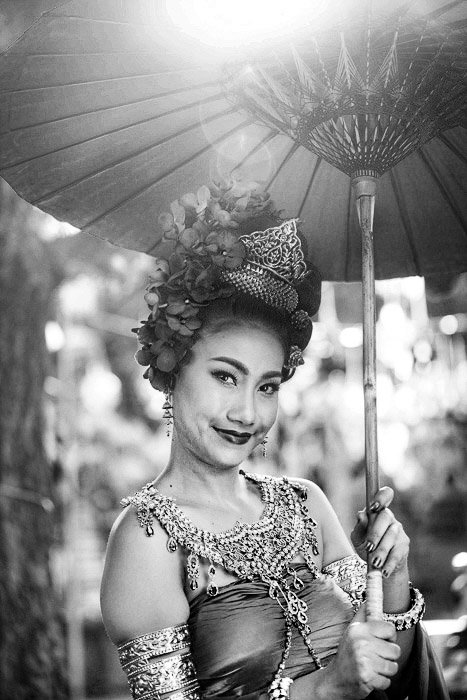 monochrome portrait of a thai dancer holding an umbrella - how to remove glare in photos