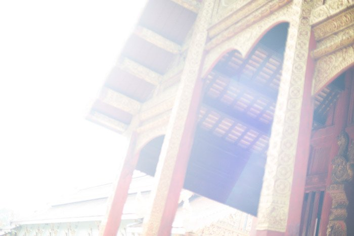 The exterior of a temple featuring lens flare - how to remove glare in photos