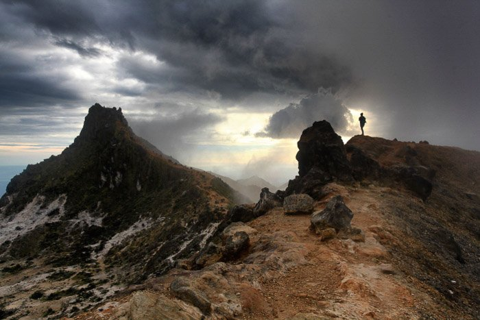 A stunning volcanic landscape under cloudy sky