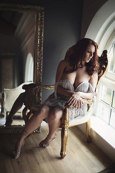 Sensual self portrait boudoir photography of a female model posing in a lavish interior