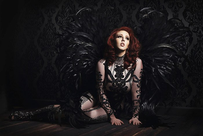 Atmospheric self portrait boudoir photography of a female model posing in a Gothic style interior