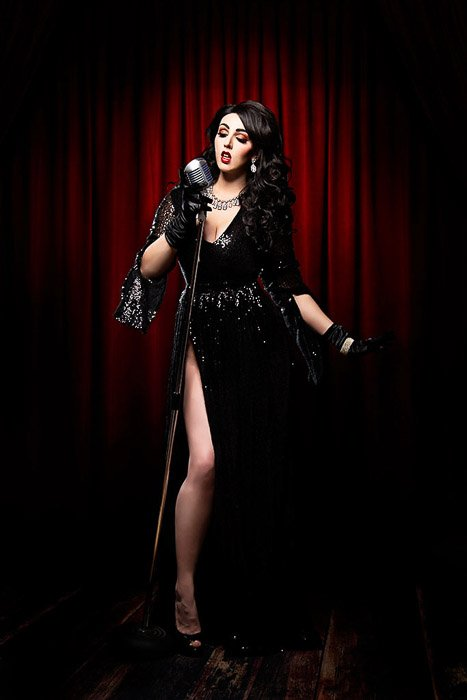 Atmospheric self portrait boudoir photography of a female model posing in a Gothic style cabaret stage