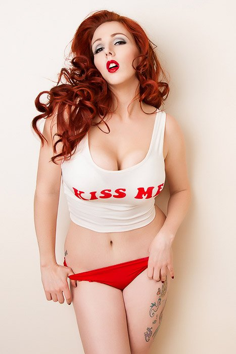 Sensual self portrait boudoir photography of a female model with red hair