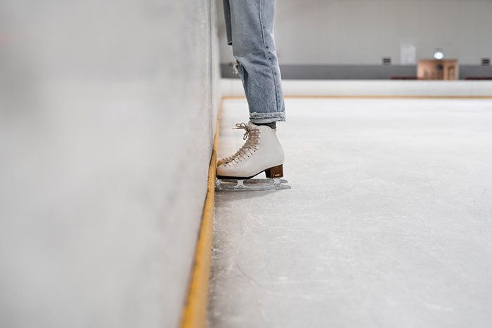 A close up of an ice skaters feet