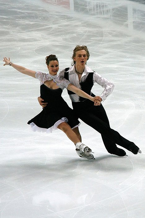 Beautiful figure skating photography of a couple dancing on the ice
