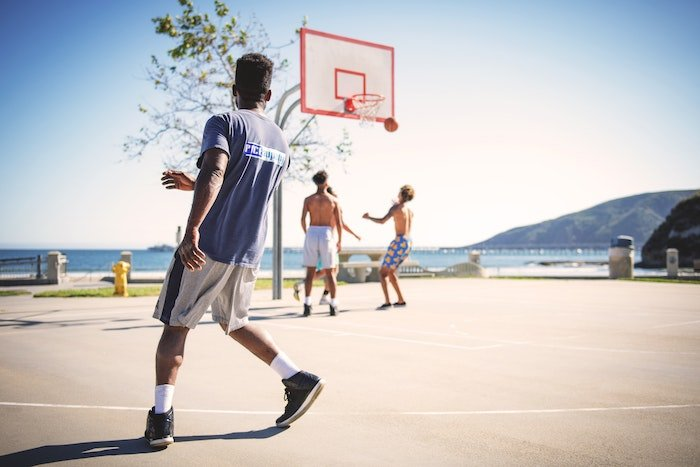 A candid shot of basketball players on an outdoor court