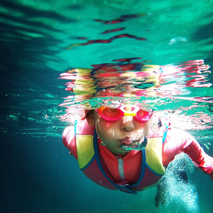 Atmospheric underwater photo of a swimmer