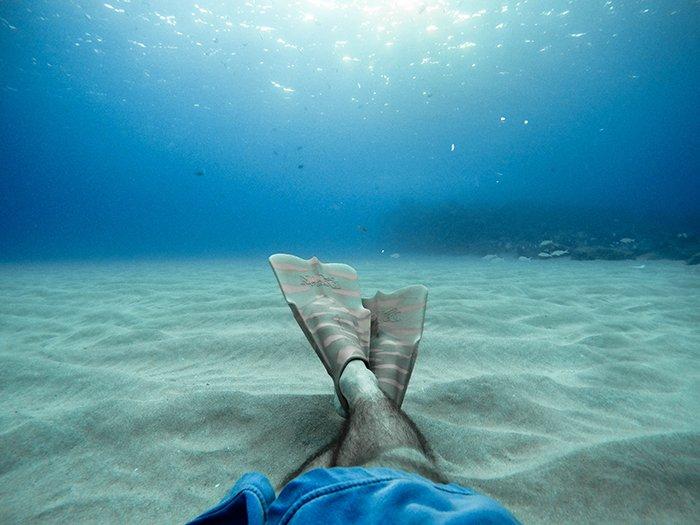 Cool underwater portrait of a swimmers crossed legs