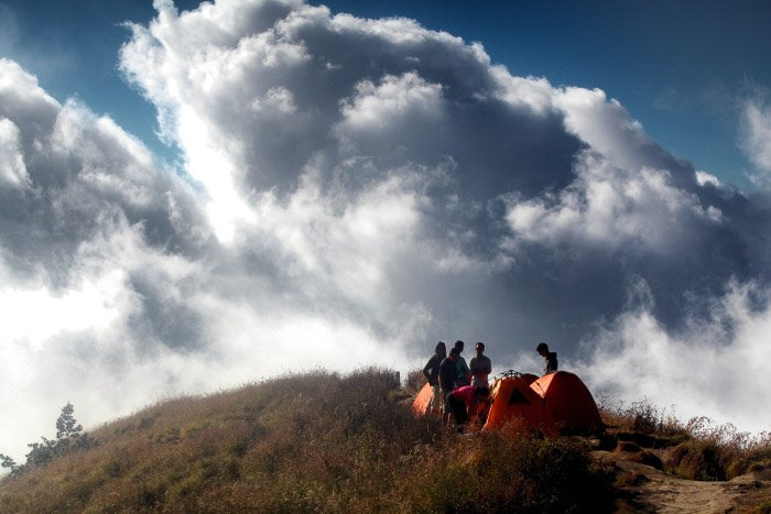 Photographers climbing a volcano on a cloudy day-volcano and lava photography
