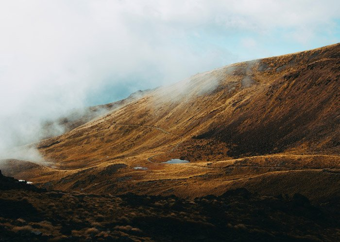 A stunning yellowed and brown mountainous landscape - color theory for landscape photography