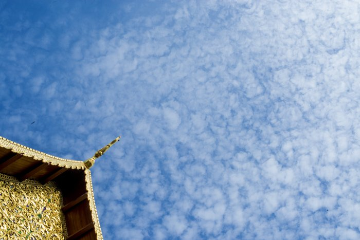 the roof of a Thai temple shot with a dutch angle