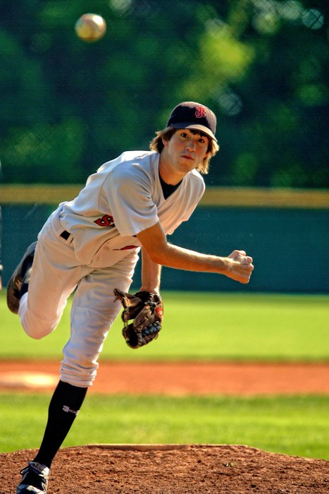 A man throwing a baseball for fast shutter speed baseball photography