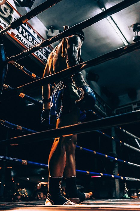 Atmospheric boxing picture of a fighter in the ring during a match
