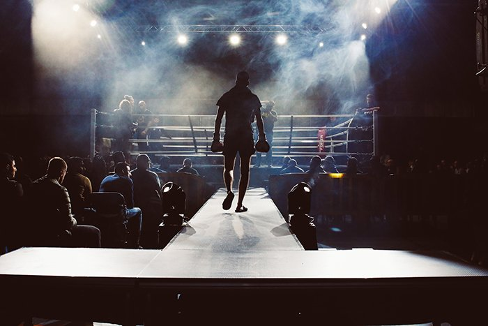 Atmospheric boxing picture of a fighter walking into the ring