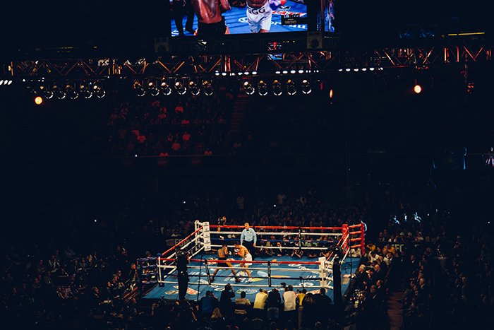 Atmospheric high angle boxing picture of fighters in the ring during a match