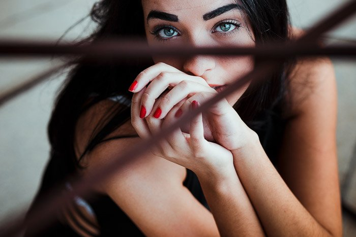A stunning portrait of a female model featuring stunning catchlight in the eyes