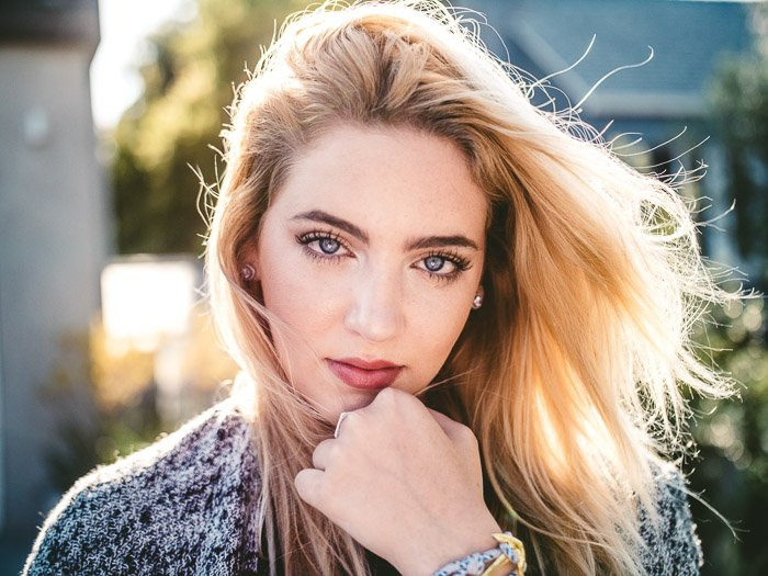 A stunning portrait of a female model featuring stunning light reflection in eyes