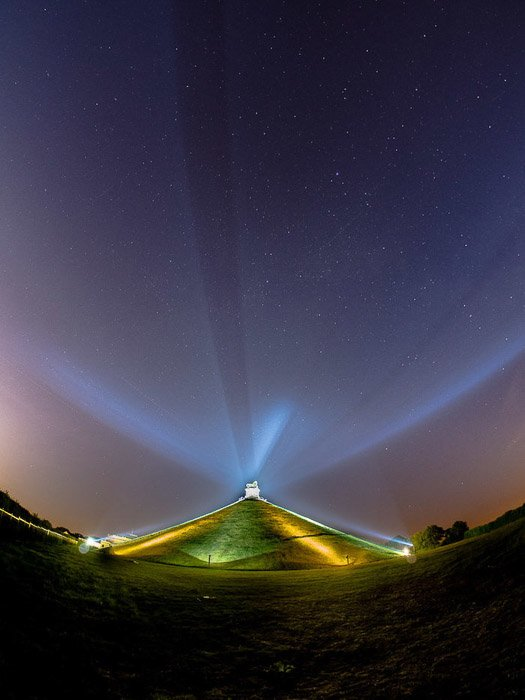 Atmospheric night photo of a building with concave horizon shot with a fisheye lens