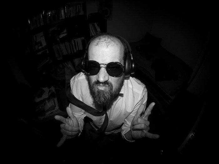 Overhead black and white fisheye portrait of a man in sunglasses