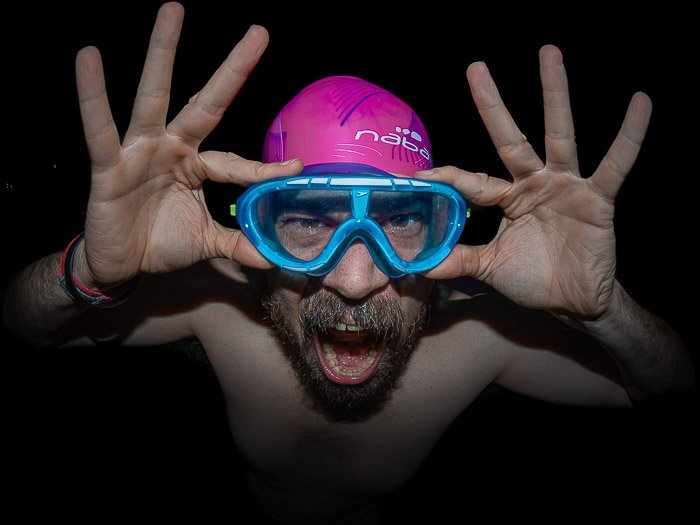 Humorous portrait of a man in swimming gear shot with a fisheye lens