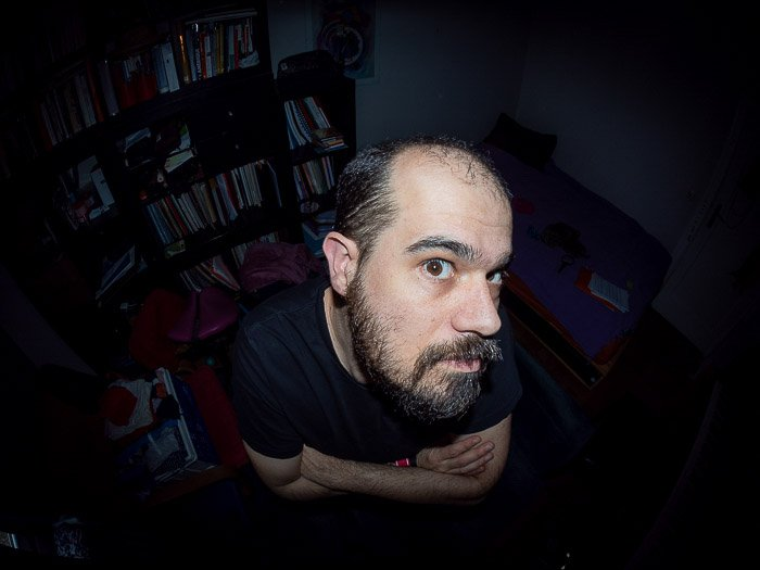 Overhead portrait of a man taken with a fisheye lens