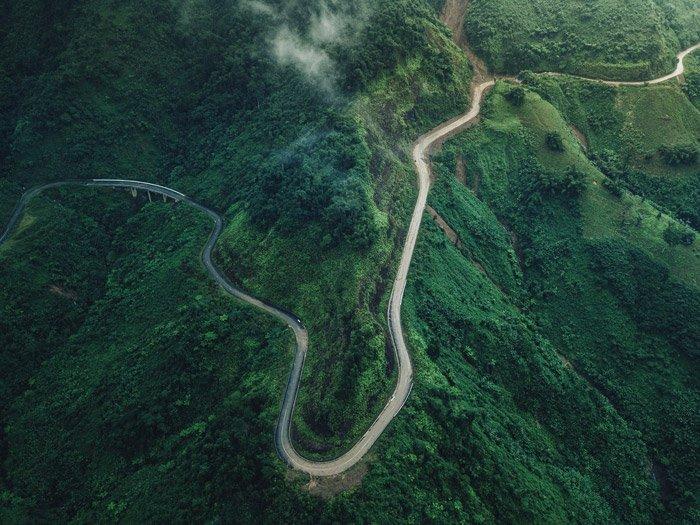 a beautiful aerial shot of a luscious mountainous landscape - stunning landscape photos