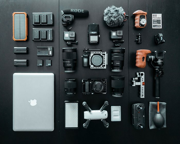A flat lay of various camera equipment for Iceland photography