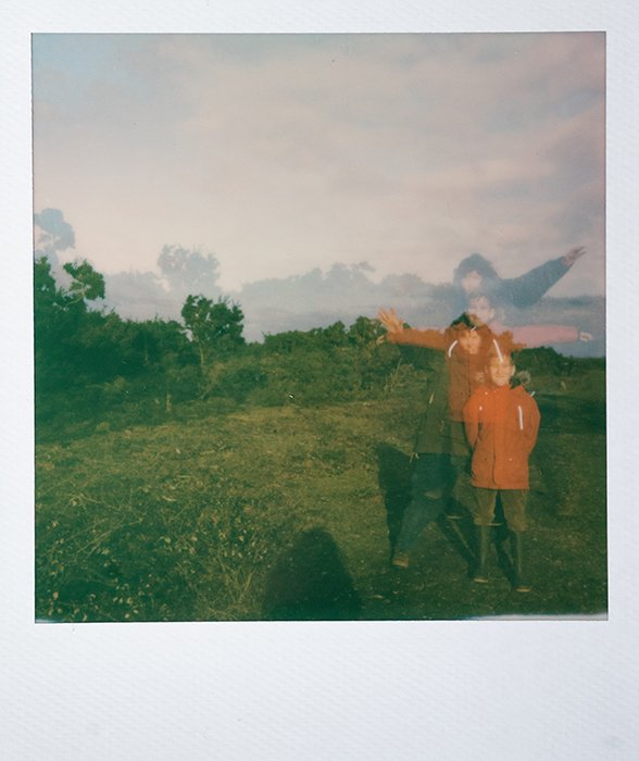 Dreamy instant photography portrait of a young boy outdoors using multiple exposure technique