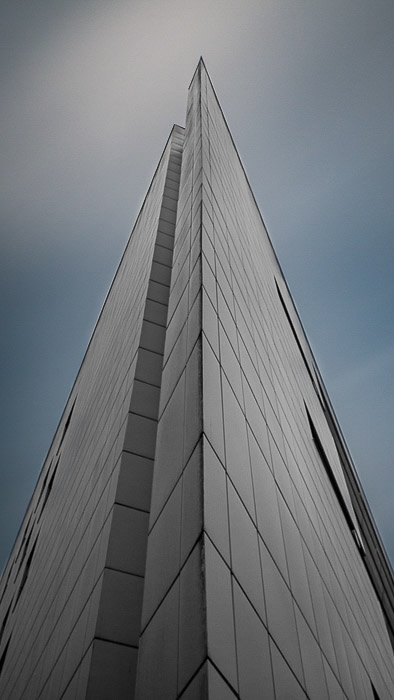 An image of a skyscraper being edited using lightroom auto mask