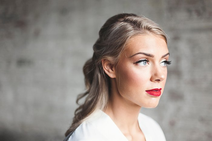 Striking portrait of a female model posing for a makeup photography shoot