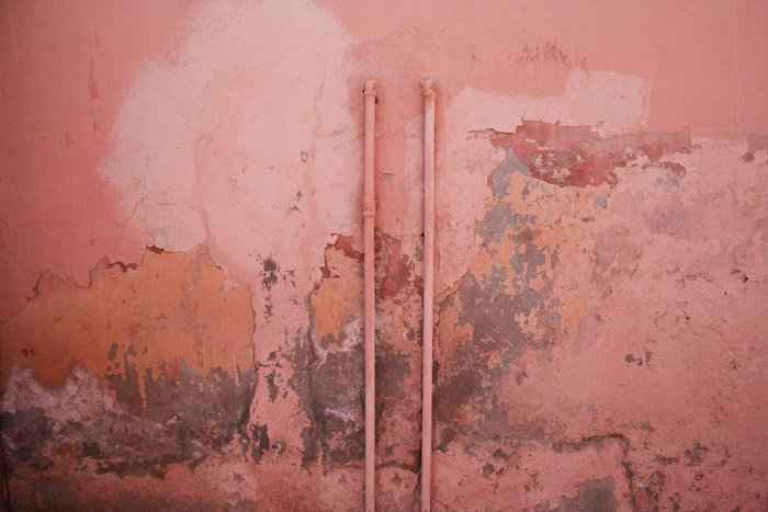 A dirty textured pink wall - photography themes