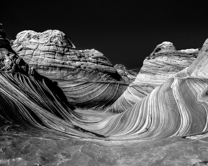 a rocky mountainous landscape shot in black and white - stunning landscape photos