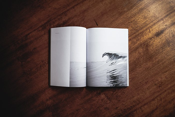 A printed photo book on a wooden table