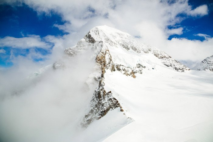 a beautiful mountainous landscape in the snow - stunning landscape photos