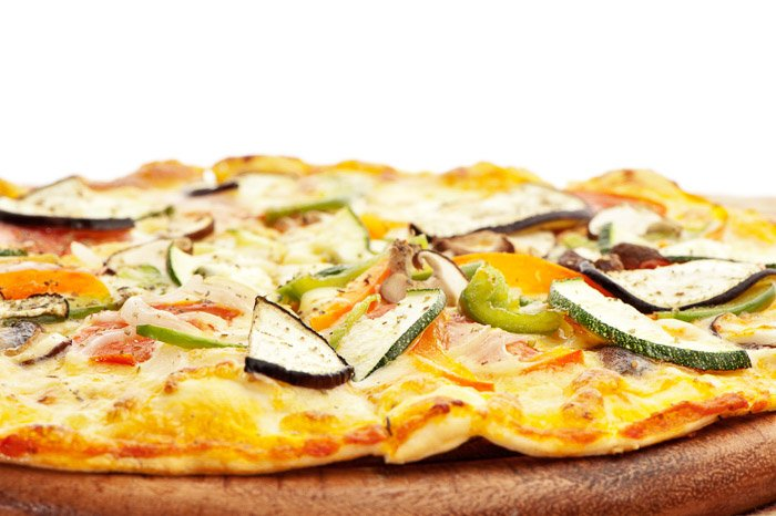 Close up of a fresh made vegetarian pizza shot with one softbox directly behind the subject.