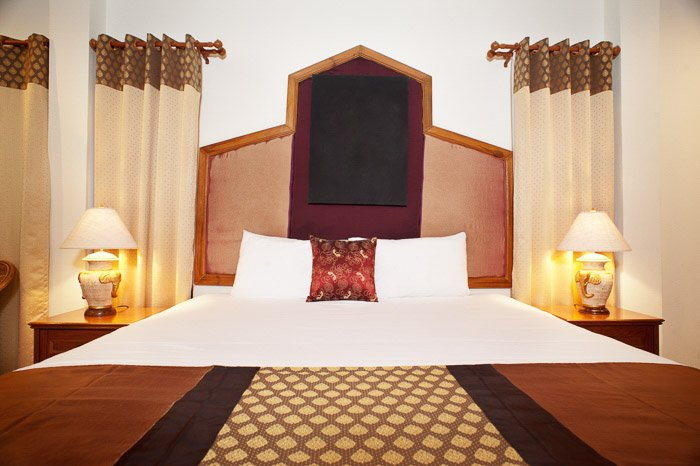 Interior of a luxury room at an Asian hotel shot with a One softbox and one reflector with a second flash bouncing off it.