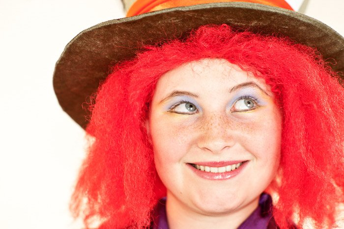 A closeup portrait of a female model dressed as the mad hatter shot using softbox lighting