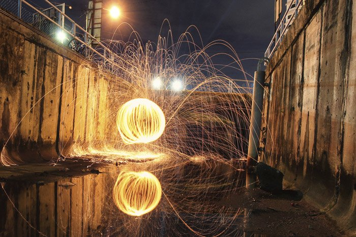 Cool steel wool photography in an urban setting at night