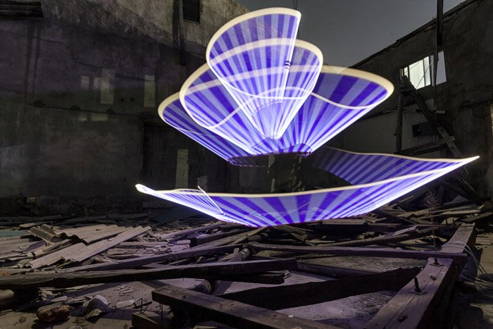 A long exposure light painting shot in an industrial ruin