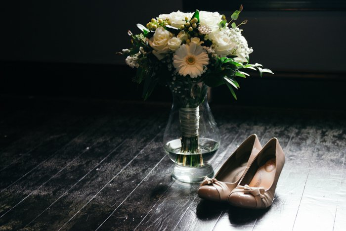 atmospheric still life of wedding shoes and flowers - wedding photography business tips