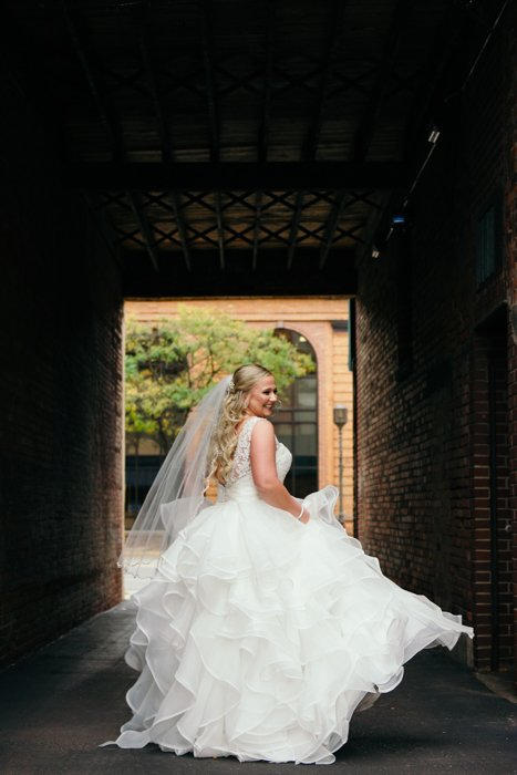 Wedding portrait of the bride posing outdoors - wedding photography business tips