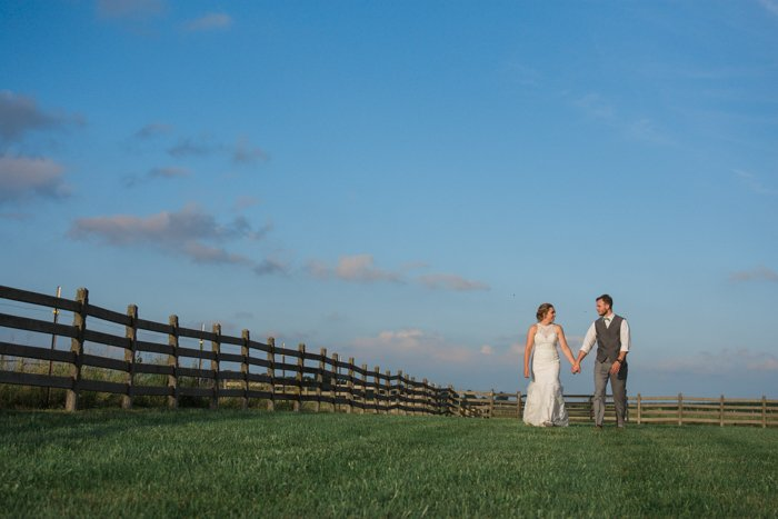 bright and airy wedding photography of a couple posing casually outdoors