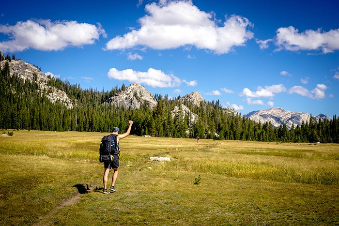 A hiker in Tuolumne Meadows, best photography spots for yosemite photos